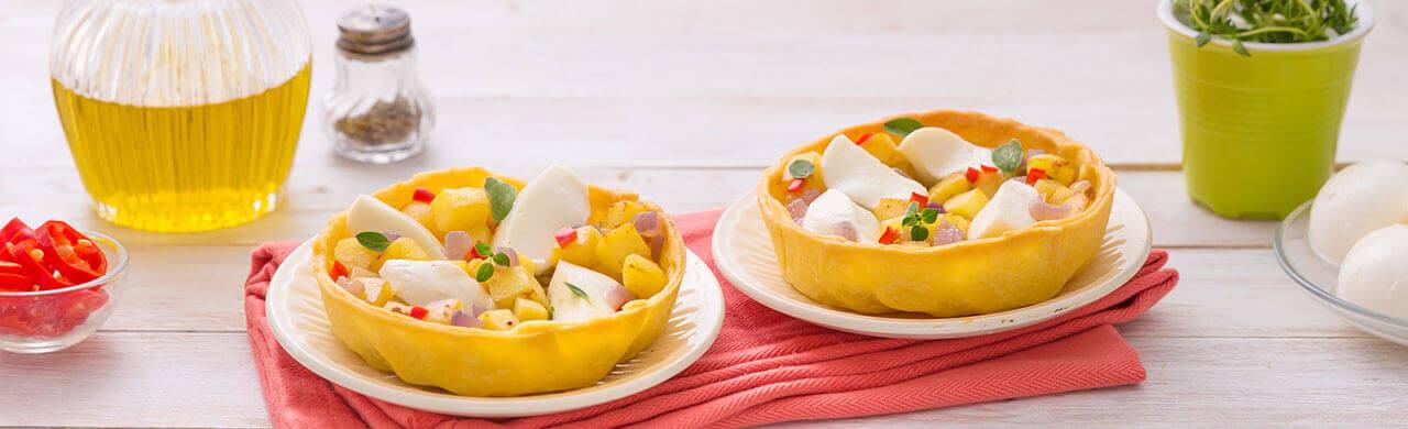 Tarte salée à base de pâte brisée aux pommes de terre, oignons et Mozzarelline Fior di Latte